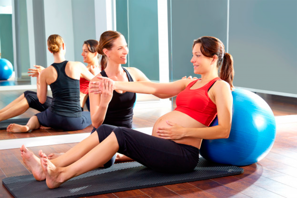 Pilates trains your body to be strong, flexible and balanced and targets the core pelvic, back and tummy muscles which can cause you problems in pregnancy. #pilatespregnantnearme #pilatesprenatalnearme #pilatespregnancyexercises #pilatesballpregnancyexercises