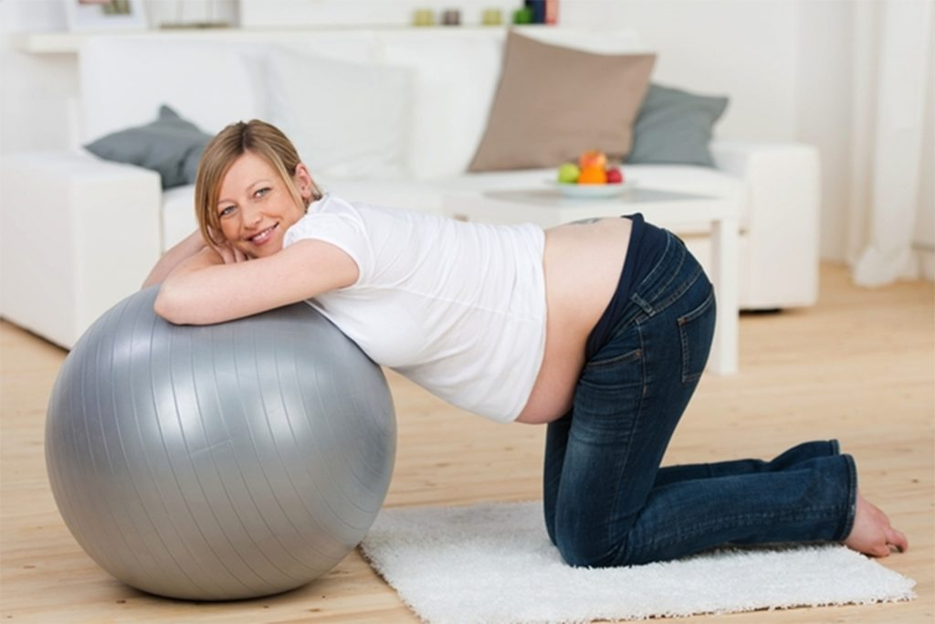 Pilates ball: A way to exercise at home and relieve back pain.